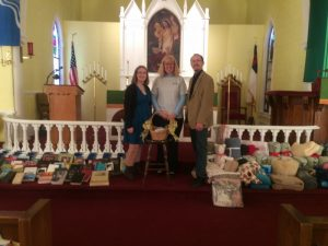 Mary Bates of NALC Disaster Response (center) and Pastor Mathew Magera and his wife, Lane, with the Bibles, blankets and offerings collected to assist U.S. victims of Hurricane Matthew.