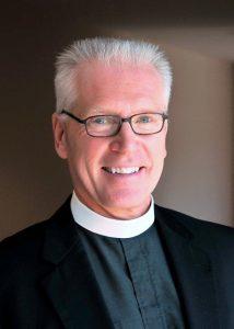 Rev. John F. Bradosky